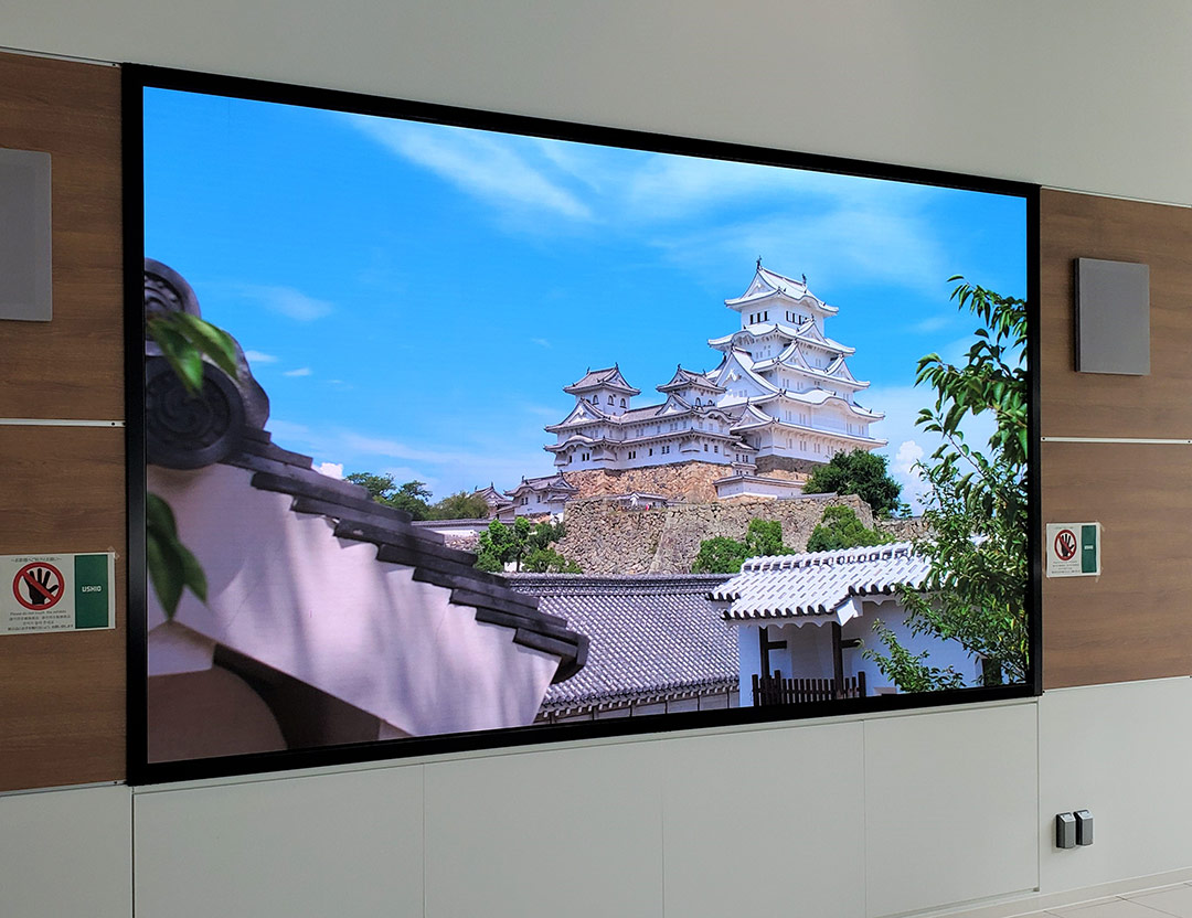 Located in an entrance lobby of The Ushio Group building in Himeji in the Kansai region of Japan, this stunning Christie<sup>®</sup> MicroTiles<sup>®</sup> LED wall is made up of ninety-eight 1.25mm tiles (14 wide x 7 high). A Christie Link E1000 video wall controller powers the content onscreen.